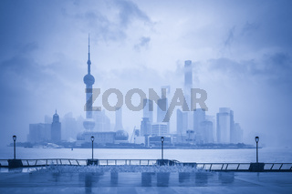 shanghai skyline in the rain