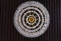 Luxury lamp on the ceiling. Abstract electricity concept background.