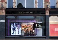 Display of fashion advertising in debenhams department store window in Kirkgate leeds