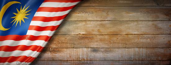Malaysian flag on vintage wood wall banner