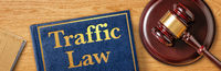 A gavel with a law book - Traffic Law