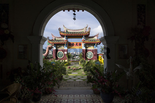 Arch at Kek Lok Si temple overlooking temple and skyline of Georgetown, Penang, Malaysia