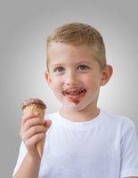 Happy kid boy ready for eating chocolate ice cream