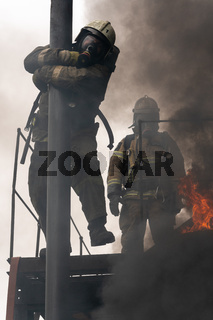 Firefighters Fire Service during fire extinguishing