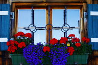 Window from the farmhouse with blue shutters and beautiful flowers  jewelry