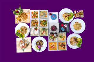 Asian Thai food on white plates with purple background with copy