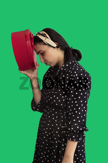Unhappy woman with red gift box