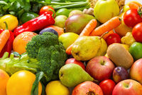 Assorted fresh raw fruit and vegetable in close up.