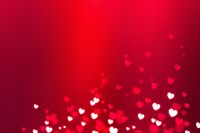 Glowing white hearts with bokeh effect