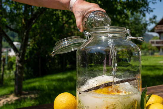 Pour the vodka into the big jar with the ingredients for the elderflower liqueur