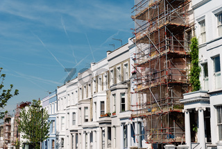 Traditional townhouses in Notting Hill, one of which is being restored