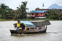 Traditional tambang ferry boat on the Sarawak river, Kuching, Sarawak, Borneo, Malaysia
