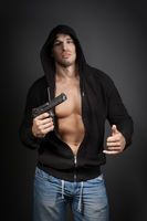 male gangster holding a gun isolated on gray background