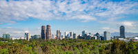 Panoramic view of Mexico city skyline on sunny day.
