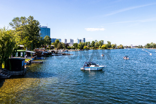 View on Old Danube River, ger. Alte Donau, with Boats, Landscape and Buildings in Vienna, Austria, Europe