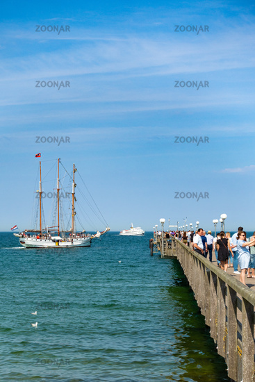 Seabridge of Binz with docking sailing ship and excursion boat, summer 2020, Rügen, Germany