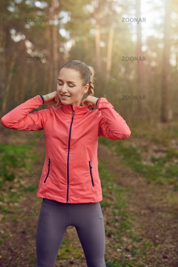 Fit healthy young woman outdoors at sunset