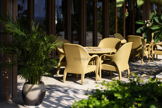 Vacation resort with table and chair set for relaxed