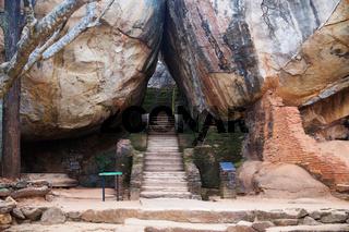 Stairs between some huge orange rocks in Sigiriya, Sri Lanka