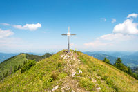 The summit cross of the Almkogel, a mountain in the Enns valley in Upper Austria