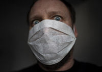 Man with face mask - fear of infection