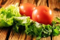 tomatoes and greens on the  table