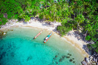 Aerial view of tropical beach and two longtail boats