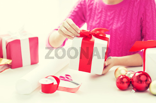 close up of woman decorating christmas presents