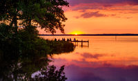 Beautiful romantic sunset over a calm lake