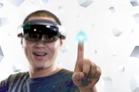 Step into virtual reality with hololens glass. Mixed reality and advanced technology concept.