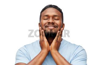 happy african american man touching his beard