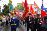 Anapa, Russia - May 9, 2019: Veterans carry a portrait of Stalin at a celebration in honor of Victory Day