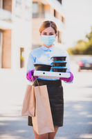 Delivery women in medical mask and rubber gloves