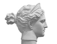 White marble sculpture head of young woman. Statue of sensual renaissance art era naked woman in circlet antique style isolated on white background