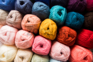 Various color balls of yarn as a background