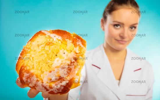 nutritionist holding sweet food