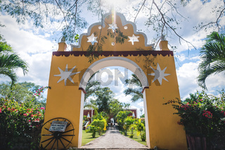 Traditional hacienda entrance leading into garden at the San Lorenzo Hacienda at the Oxman Cenote, Yucatan, Mexico