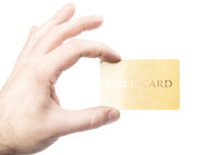 male hand holding gold credit card isolated