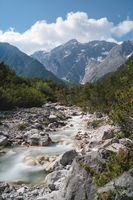 Clear fresh mountain river in the alpine landscape and rocky tops, Mieming, Tirol, Austria