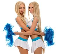 Studio photo of sexy cheerleaders hugging