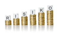 Coin stacks with letter dice - Risk - Risiko German
