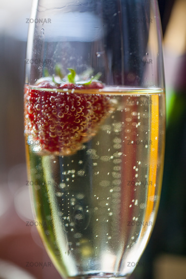 Glas of sparkling wine or champagne and strawberry