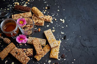 Healthy superfood composition. Various kinds granola energy protein bars with honey in jar