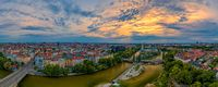 Aerial panoramic view in München with the central flowing Isar river at the aerly morning at sunrise.