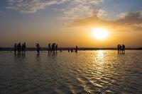 People in sunset at Danakil salt lake