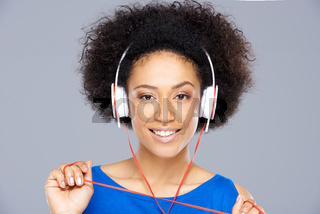 Trendy African American woman listening to music