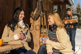 Friends spend holiday winter snow cottage