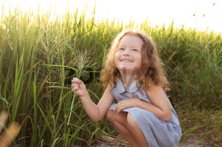 Happy little girl smile on rice field