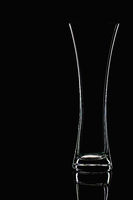Glass vase, isolated on the black background.