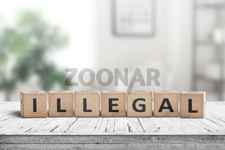 Illegal message on a wooden desk